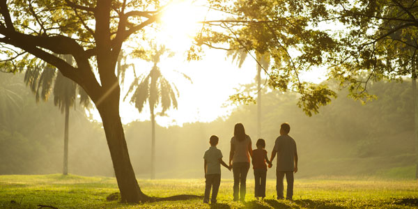 family walking into sunset